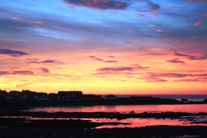 Autumnal sky over Dunbar and reflection in the sea